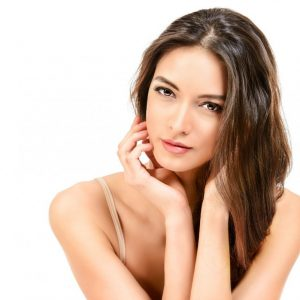 43896647 - beautiful sensual woman touching her face. beauty and skincare concept. spa. isolated over white.