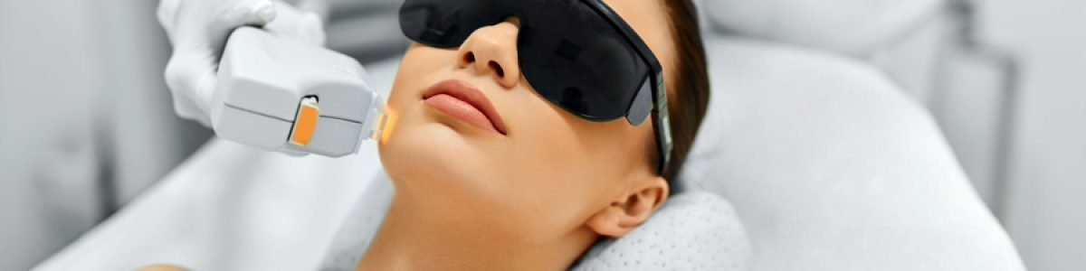 49277002 - skin care. young woman receiving facial beauty treatment, removing pigmentation at cosmetic clinic. intense pulsed light therapy. ipl. rejuvenation, photo facial therapy. anti-aging procedures.
